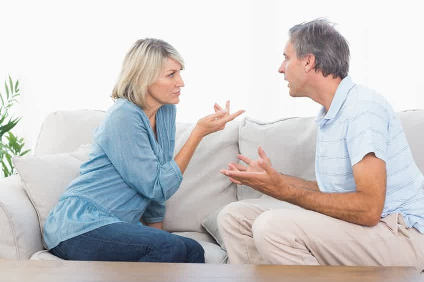 20626798 - couple having an argument at home on couch