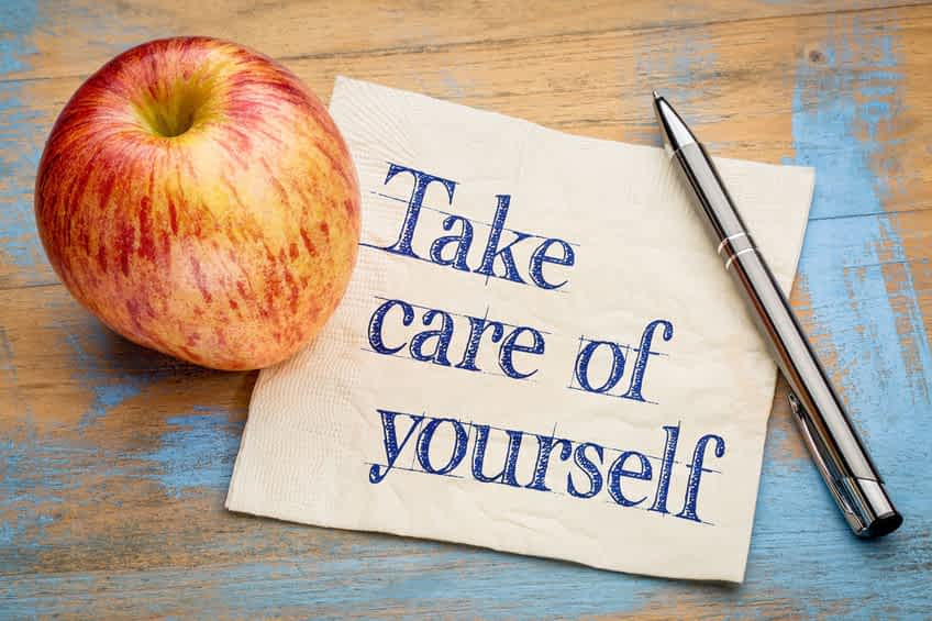 57103030 - take care of yourself advice or reminder - handwriting on a napkin with a fresh apple